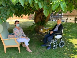 Family reunited with resident in garden at Crouched Friars